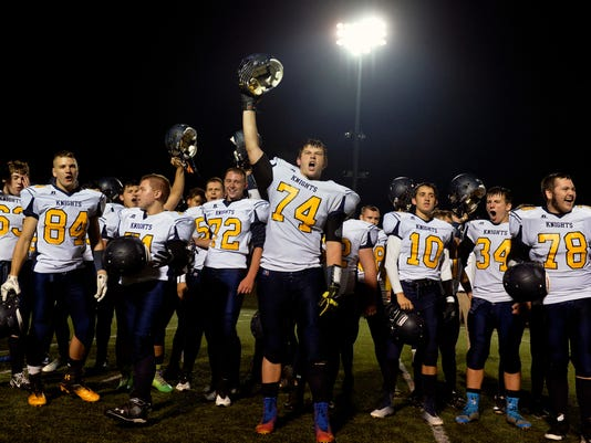 Eastern York football players cheer after singing the alma mater after a football game at Susquehannock on Friday, Oct. 10, 2014. Eastern York defeated Susquehannock, 48-0. (Chris Dunn -- GameTimePA.com)
