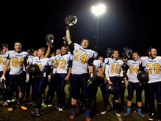 Eastern York football players cheer after singing the alma mater after a football game at Susquehannock on Friday, Oct. 10, 2014. Eastern York defeated Susquehannock 48-0. Chris Dunn Ñ Daily Record/Sunday News