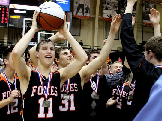 Silverton players celebrate their win following the Silverton vs. Wilsonville boy's basketball OSSA Class 5A tournament championship game at Gill Coliseum in Corvallis, Ore., on Friday, March 13, 2015. Silverton won the championship 33-32.