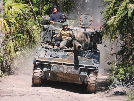Mark Malek and David Bishop navigate an Abbot FV433 self-propelled artillery across the Tank America property last month during a United Way of Brevard event.