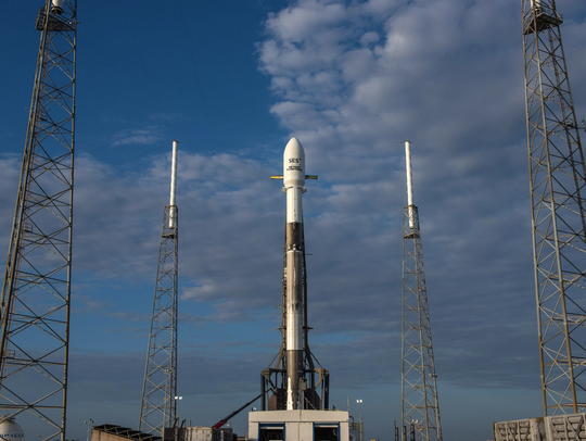 SpaceX's Falcon 9 rocket sits on the pad at Cape Canaveral