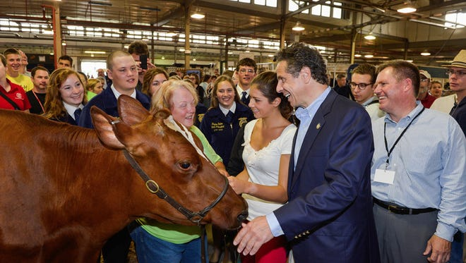 Cuomo visiting the State Fair near Syracuse in 2014.
