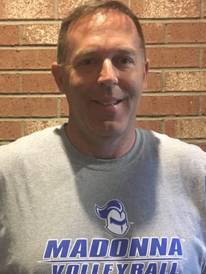Although volleyball coach Mark Grenier is leaving Churchill, he is staying in Livonia -- with the Madonna Crusaders.