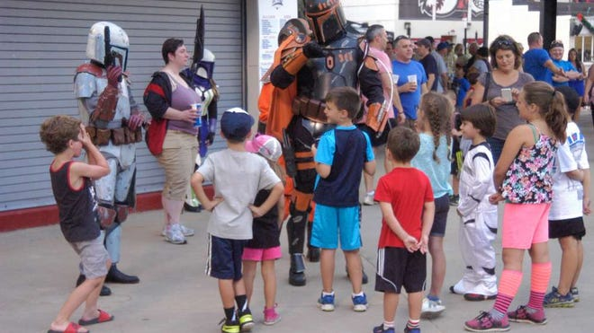 Children gather around and interact with people dressed as Star Wars characters during the New Jersey Jackals' Star Wars Night event last year.