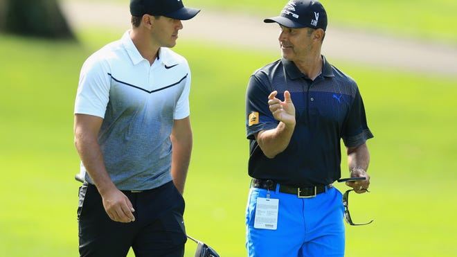 Claude Harmon III (right), of the Floridian in Palm City, saw student Brooks Koepka (left) win his second straight PGA Championship on Sunday, May 19, 2019. Another of Harmon's students, Dustin Johnson, finished second. (Andrew Redington/Getty Images)