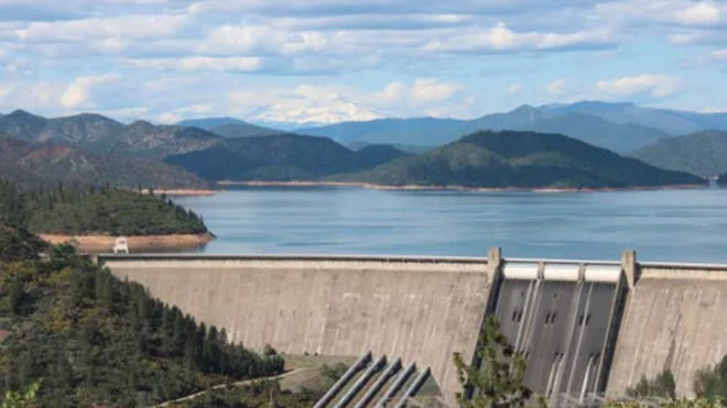 Visitors can see Mt. Shasta in the distance over Lake Shasta and the Shasta Dam on Friday, April 24, 2020.