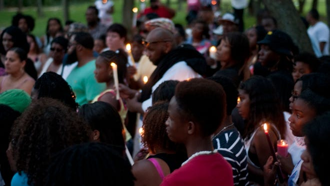 Family and friends share their grief at a memorial ceremony Tuesday for Jeffrey Corbett Jr.