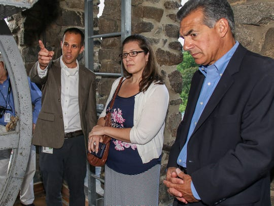 Jon Wagar, left, deputy director of Duke Farms, explains renovations in the clock tower to Jacqueline Morales, director of tourism for Somerset County, center, and assemblyman Jack Ciattarelli, as Duke Farms celebrated the renovation of its Coach Barn on June 29, 2016, the first of three iconic stone barns constructed by James Buchanan Duke.