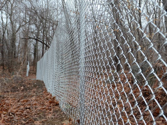 Fencing around sinkholes in Ringwood mines area