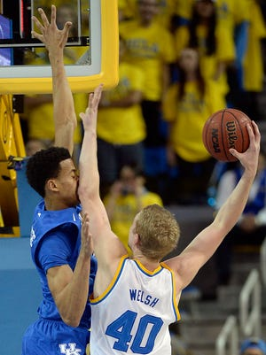 Dec 3, 2015; Los Angeles, CA, USA; UCLA Bruins center Thomas Welsh (40) shoots the ball against Kentucky Wildcats forward Skal Labissiere (1) during the first half at Pauley Pavilion. Mandatory Credit: Richard Mackson-USA TODAY Sports