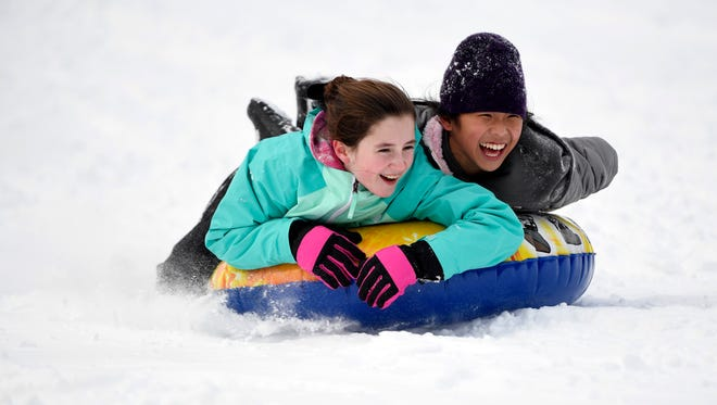 Sarah Dinnell, left, and Ai Lin Doody, both 13 of Hillsdale, sled down the hill at Atkins Glen Park after the snow stopped falling in Park Ridge, NJ on Thursday afternoon, February 9, 2017.