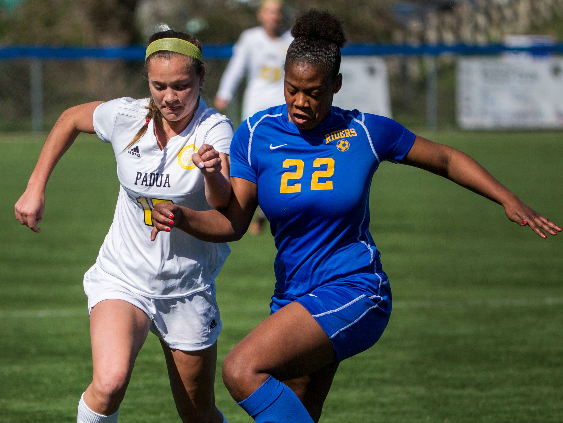 Padua's Lindsay Machamer (left) and Caesar Rodney's Jameah Nixon chase down the ball in the first half of Padua's 2-0 win over Caesar Rodney at the Hockessin Soccer Club on Tuesday afternoon.