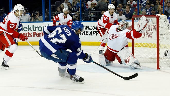 Tampa Bay Lightning defenseman Andrej Sustr (62) scores a goal on Detroit Red Wings goalie Petr Mrazek (34) during the second period in game two of the first round of the 2015 Stanley Cup Playoffs at Amalie Arena.