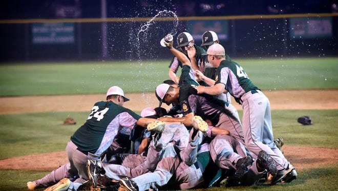 It was a mob scene on the mound as Fredericksburg celebrated Lebanon County's first Region 4 title since 1993 after beating Pleasureville 10-4 in the championship game at Earl Wenger Field Thursday night.