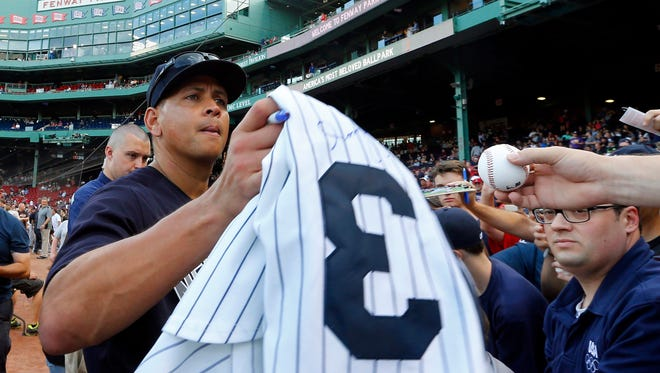 New York Yankees' Alex Rodriguez signs autographs before the team's baseball game against the Boston Red Sox at Fenway Park in Boston on Tuesday, Aug. 9, 2016.