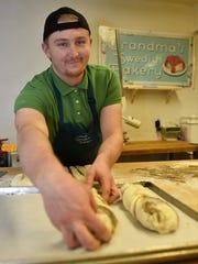 Stefan Promoroaca of Romania prepares braided cardamon rolls for the oven inside Grandma's Swedish Bakery at Rowleys Bay Resort in Ellison Bay on Friday, Oct. 6, 2017.