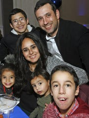 The Boyer family, Ari and Rachel with children Ben, 14, rear, and left to right Ahuva, 5, Avigail, 2 and Refael, 12, attend the Chai Lifeline annual Hanukkad gala in Lakewood December 11, 2017.  Photo by Vincent DiSalvio / Special to The ASBURY PARK PRESS