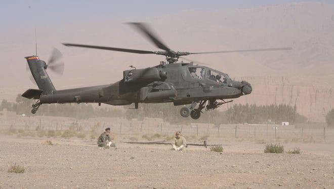 Arizona Army National Guard Chief Warrant Officer Royal Hazen and Chief Warrant Officer Jennifer Languell take off in an AH-64D Apache near Bamyan, Afghanistan, while deployed in support of Operation Enduring Freedom in October, 2007.