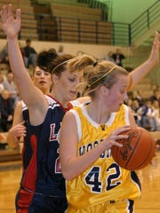 Megan Abbey is among Woodmore's 1,000-point scorers.