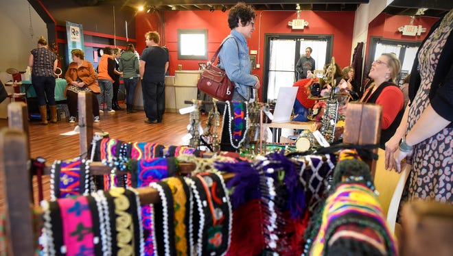 Shoppers look though a wide variety of items on display during the Shop Small Market featuring locally-made arts, crafts and food Saturday, Nov. 25, at Revolver Studios in St. Cloud.