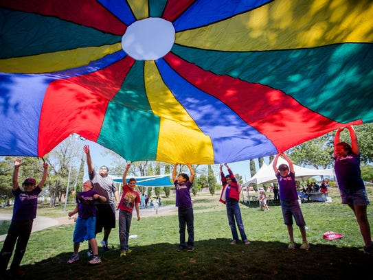 Students from Sonoma Elementary School raise a parachute