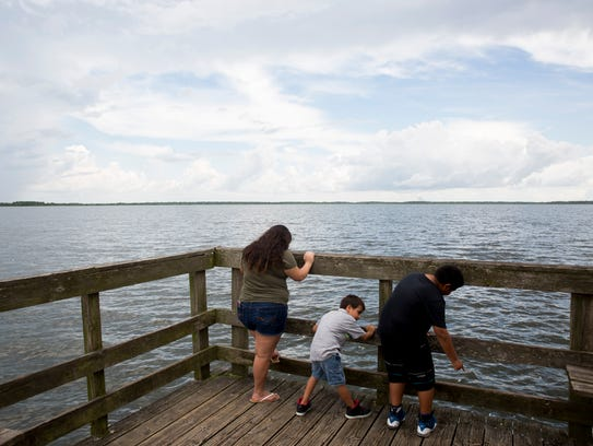 Maritza Gonzalez, 16, enjoys the Lake Trafford pier