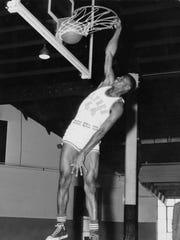 Warren Sutton as a basketball  player at Alfred University.