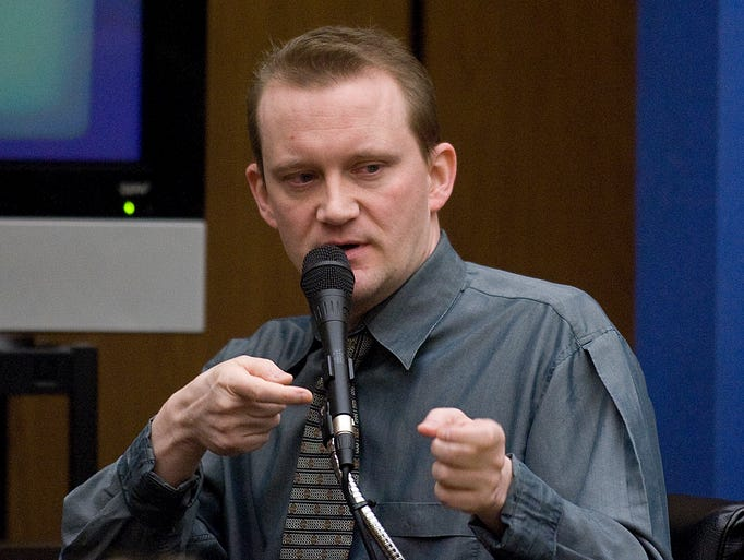 Dale Hausner, takes the stand in his own defense during his trial. He was sentenced to death six times.