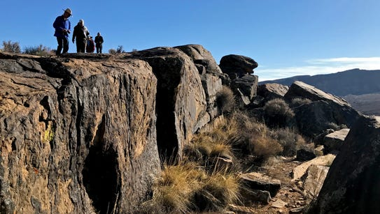 Participants in Tuesday's BackTrek charity hike examine