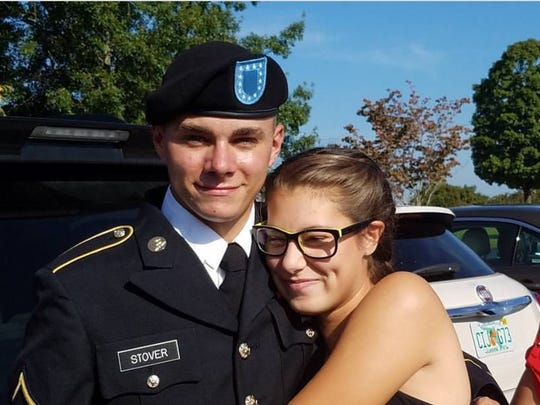 Abigail Osborn, right, hugs her brother, Brad Stover. Osborn died of injuries related to a hit-and-run Monday afternoon.