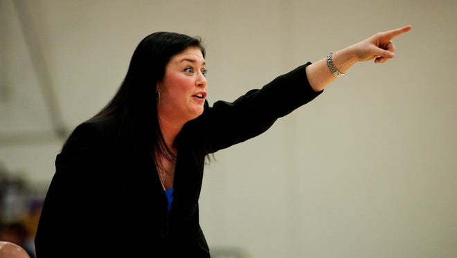 Vermont women's basketball assistant coach Shannon Bush yells instructions to the team during a game in the 2011-12 season. Bush has left UVM to take an assistant-coach position at Siena.