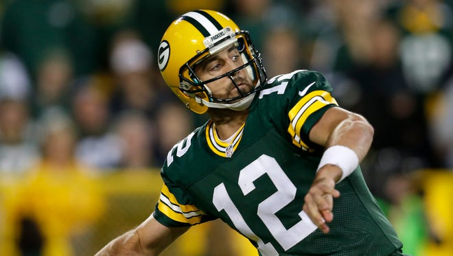 Green Bay Packers quarterback Aaron Rodgers throws long in the second quarter against the Seattle Seahawks.