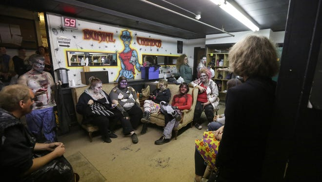 After getting into character, performers wait for darkness Oct. 10 at the Burial Chamber in Neenah.