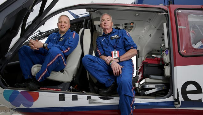 Adam Lenth (left) and his father Tim Lenth work together as flight nurses for the ThedaStar team Tuesday, June 14, 2016 at ThedaCare Regional Medical Center in Neenah, Wis. Tim has been a flight nurse since 1992 and his son Adam has been part of the team since August of 2015.