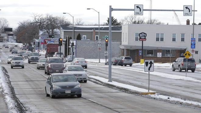 Vehicles travel down Oshkosh Avenue at North Sawyer Street, Wednesday, Jan. 3, 2018, in Oshkosh. The intersection is part of a redevelopment district the city hopes to create.