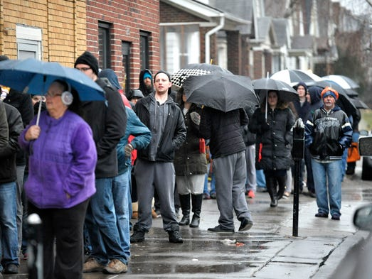 Customers line up in the rain along Yemans in Hamtramck,