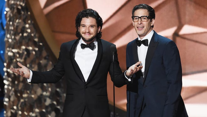 Actors Kit Harington (L) and Andy Samberg speak onstage during the 68th Annual Primetime Emmy Awards at Microsoft Theater on September 18, 2016 in Los Angeles, California.