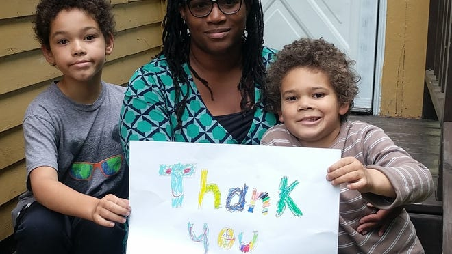 Newly elected A-B School Committee Member Kyra Wilson Cook is pictured with her sons.