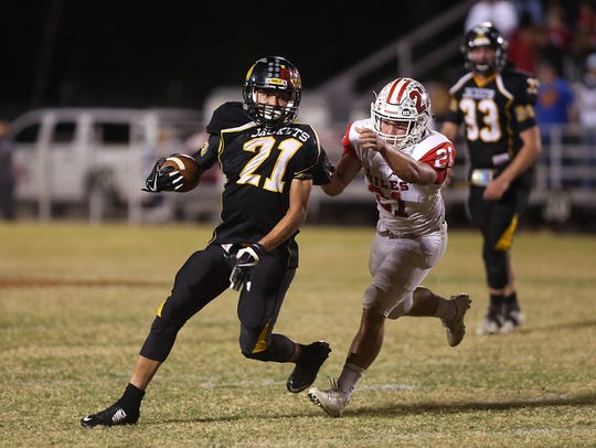 Miles' Gary Gabrielli attempts to tackle Menard's Christian