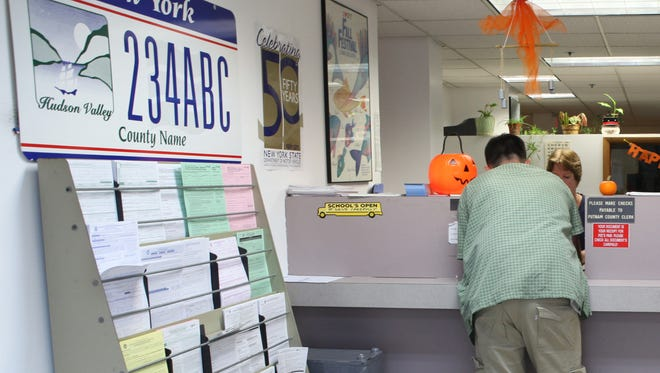 A patron is helped at the Putnam County Department of Motor Vehicles in Southeast. (file photo)