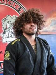 Mike Carbullido, winner of double gold medals at the Jiu-Jitsu federation of Japan All Japan 2015 Tournament, gets psyched up to train at the Carlson Gracie Academy in Anigua on Dec. 31.