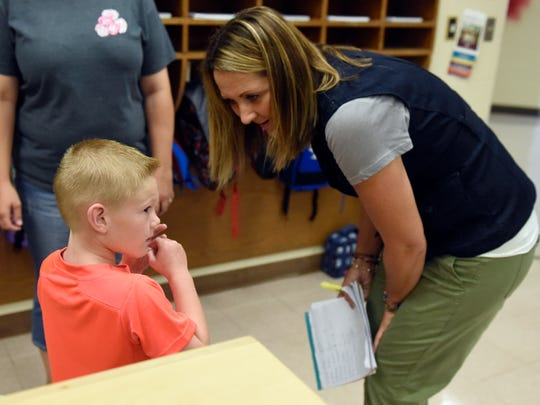 Instructional assistant Done' McAlvain speaks with