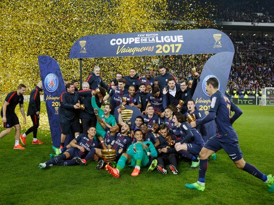 Paris Saint Germain' players celebrate with their trophies after winning the League Cup final soccer match against Monaco, in Decines, near Lyon, central France, Saturday, April 1, 2017. (AP Photo/Laurent Cipriani)