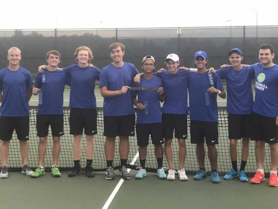 The Memorial boys tennis team celebrates winning the