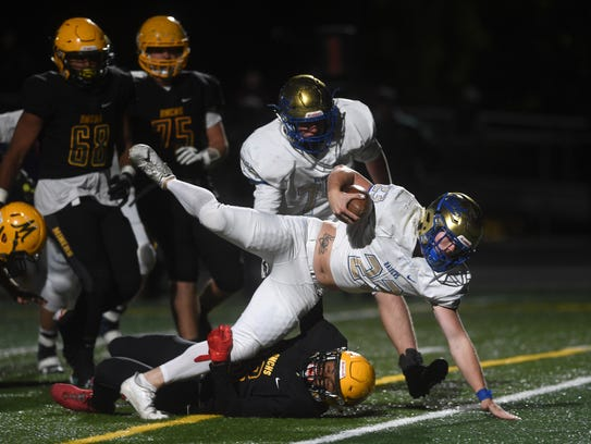 Reed's Champ Robertson (23) falls into the end zone