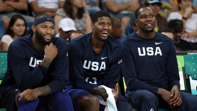 Paul George (13) and Kevin Durant (5) laugh on the bench during the game China in the men's basketball group A  preliminary round during the Rio 2016 Summer Olympic Games at Carioca Arena 1.