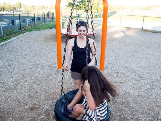 Ahna Wilson, of Gettysburg, plays with her daughter
