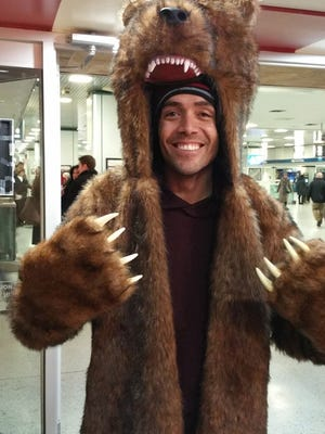 "Dressed to stay warm -- grizzly bear garb at Penn Station in Pennsylvania --  Cicero Goncalves makes a break from what was expected to be a historic blizzard, heading north on a train to Vermont, on Sunday, Jan. 26, 2015.  He traveled by train in anticipation of his flight being canceled, as thousands were on Monday.  Goncalves, a 34-year-old flight attendant from Queens, counted himself and his travel partner as lucky. ""We'll get there before it snows, and we're coming back when the storm is over, on Thursday,"" he said."