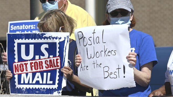 Supporters at the Main Southfield Post office worried about the crisis facing the U.S. Postal Service demonstrate on Tuesday in Southfield, Mich.