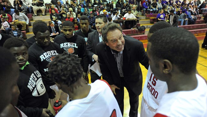 North Caddo coach Ron Meikle draws up a play during a playoff win last season.